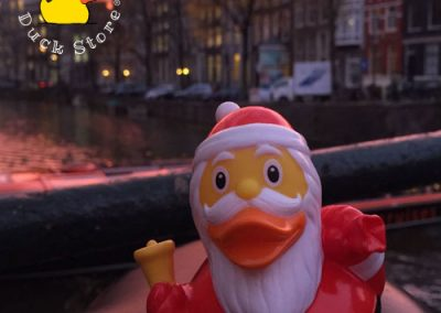 Who's that duck with bell and bag creeping along the canals of Amsterdam? It's, it's..